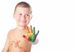 kid-with-painted-hand_1187-2971